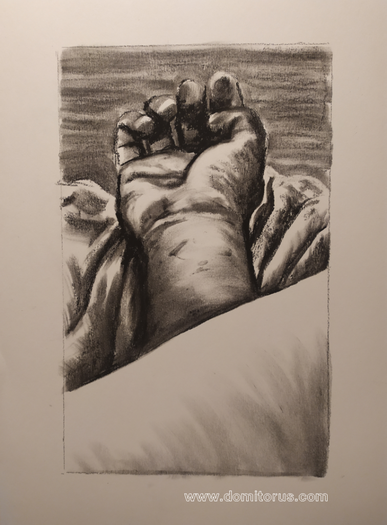 A charcoal-on-paper drawing of a hand resting palm upwards on sheets